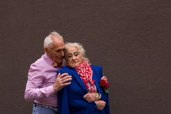 An old man gently embraces the elderly woman. An old men gently embraces the elderly woman. True love Stock Photo