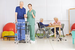 Old man and geriatric nurse holding thumbs up Royalty Free Stock Image