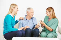 Old man getting blood pressure monitoring Royalty Free Stock Image