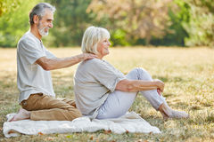 Old man gives a massage to his wife Stock Image