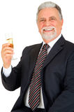 Old man with glass of champagne Stock Photography