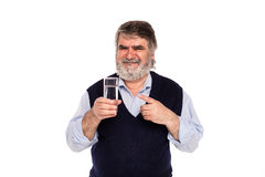 Old man with glass of water Stock Photography