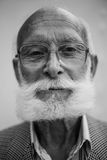 Old man with glasses Stock Photos
