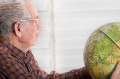 Old man with globe Stock Photos