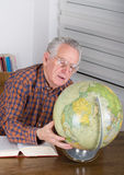 Old man with globe Stock Image