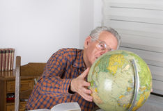 Old man with globe Royalty Free Stock Image