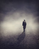 Old man going alone Royalty Free Stock Images