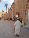 Old man going to pray. This old man went right before us to pray into the Mosque. We couldn& x27;t enter though as it& x27;s forbidden for non-muslims Stock Images
