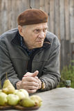 Old man grandfather is sad to think about retirement benefits Royalty Free Stock Image