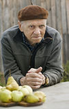 Old man grandfather is sad to think about retirement benefits Stock Photography