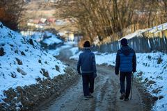 Old man and grandson walking in the countryside Stock Photo