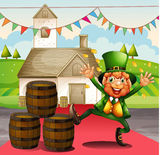 An old man in a green attire beside the barrels Stock Images