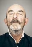 Old man. An old man with a grey beard royalty free stock photos