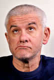 Old man grimace. Autoportrait, self-portrait, Senior funny bald man is making grimaces Stock Image