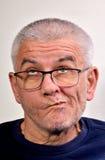 Old man grimace. Autoportrait, self-portrait, Senior funny bald man is making grimaces Stock Photos