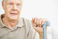 Old man with hand on cane Stock Photography