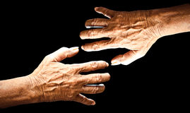 Old man hand isolated on black background Stock Photo