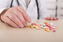 Old man hand with pills Stock Image