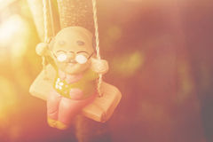 old man happy swing doll in the park vintage color tone, Happy L Stock Photography