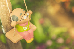 Old man happy swing doll in the park vintage color. Stock Photos