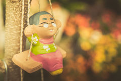 Old man happy swing doll in the park vintage color tone Royalty Free Stock Photos