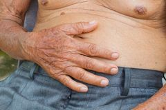 Old man has stomachache Stock Images