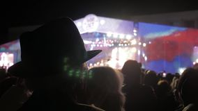 Old man in a hat at a concert. crowd at concert - summer music festival. Concert crowd attending a concert, people. Old man in a hat at. crowd at concert stock video footage