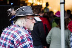 Old man in hat at festival Stock Photography