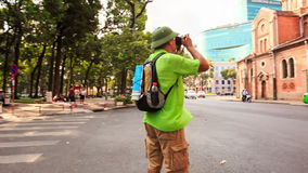 Old Man in Hat Photos Catholic Temple in Ho Chi Minh stock video footage