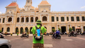 Old Man in Hat Photos Ho Chi Minh City Hall from across Street stock footage