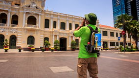 Old Man in Hat Photos Ho Chi Minh City Hall from across Street stock video footage