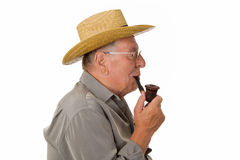 Old man with hat smoking pipe Royalty Free Stock Image