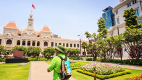 Old Man in Hat Walks to Ho Chi Minh City Hall Photos stock video footage