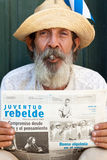 Old man in Havana  with a cuban newspaper Royalty Free Stock Photos