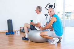 old man having back massage on exercise ball Stock Image