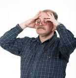 Old man having a headache. Portrait of old man having a headache on white background royalty free stock photo