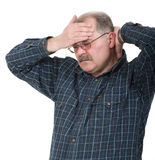 Old man having a headache. Portrait of old man having a headache on white background stock image