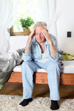 Old man having headache Stock Photo