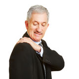 Old man having shoulder pain Stock Images