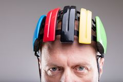 Close up of a bike helmet on an old man Royalty Free Stock Photography