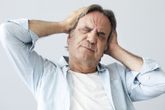 Old man with headache Royalty Free Stock Images