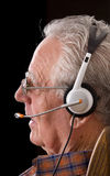 Old man with headset Stock Image