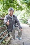 Old man with health knee. And climb moutain Royalty Free Stock Photos