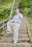 Old man with health knee. And climb moutain Royalty Free Stock Image