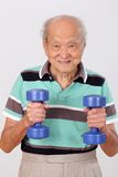 Old man healthy exercise hold dumbbell Royalty Free Stock Images