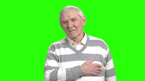 Old man heart attack. Grandpa having pain in his heart and touching his breast. Hromakey backgorund for keying stock footage