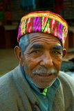 Old man of Himachal in India. Innocent village man of hilly Himachal Pradesh with traditional costume is belief in simplicity in their life. They are happy with Royalty Free Stock Images