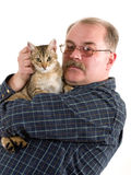 Old man with his cat. On white background Royalty Free Stock Photo
