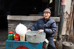 Old man and cotton candy Stock Photo