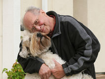 Old man and his dog. Happy senior man and his dog Royalty Free Stock Image